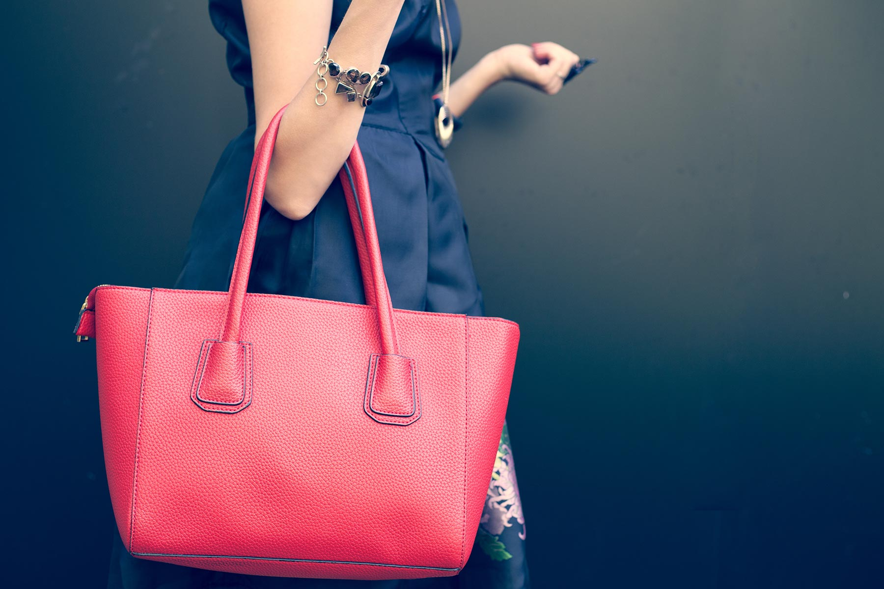 Woman carrying luxury handbag