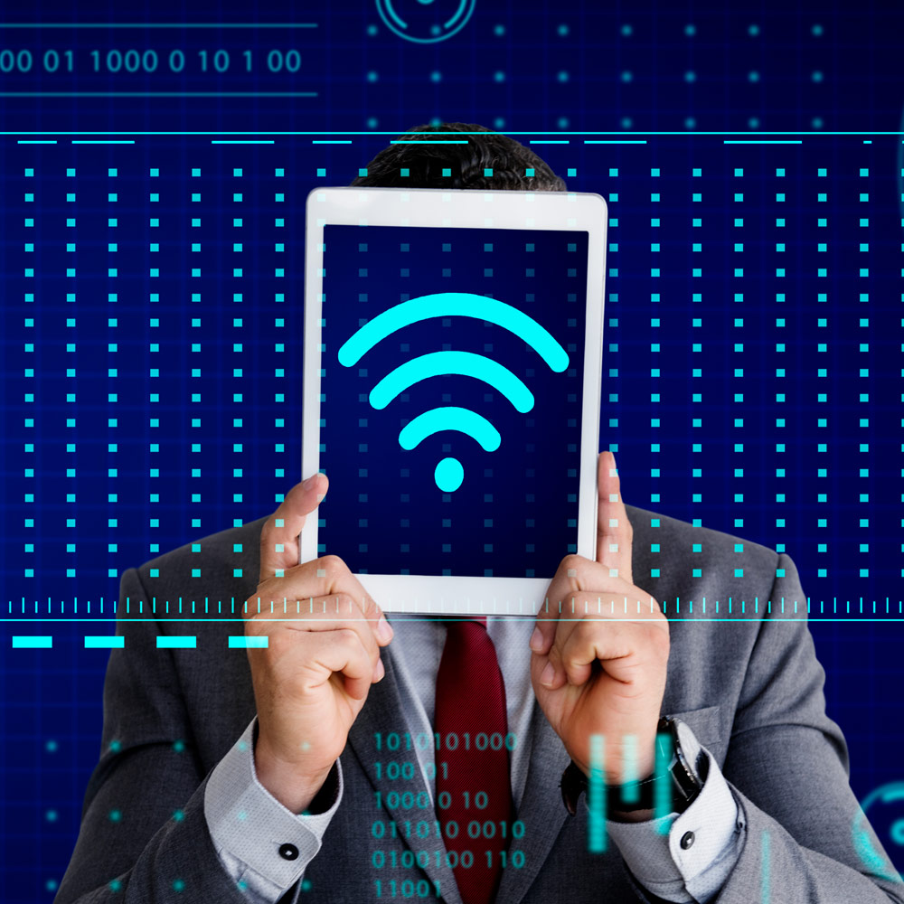 man holding iPad with WiFi symbol