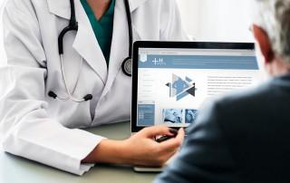 Health professional using laptop